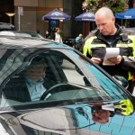 police issuing ticket for distracted driving
